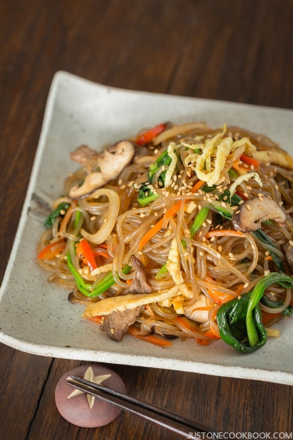 Japchae, Korean Glass Noodles with Stir-Fried Vegetables and Meat on a plate.