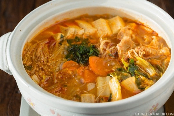Kimchi Nabe with carrot, napa cabbage and tofu in Japanese stone pot.