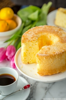Meyer Lemon Chiffon Cake on a cake stand.