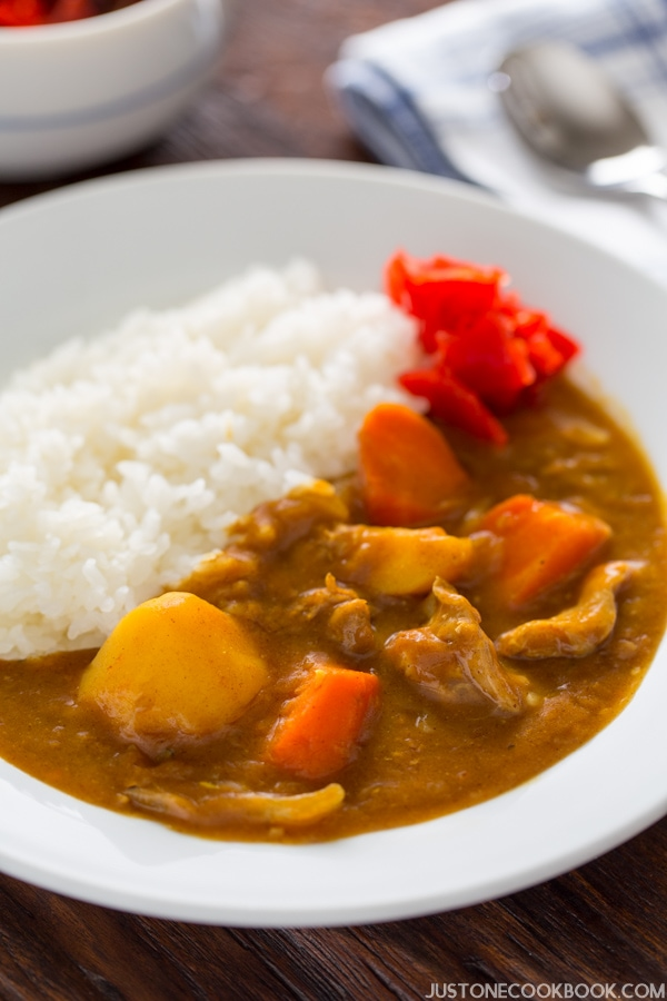 Pressure Cooker Japanese Curry and white rice in a bowl.