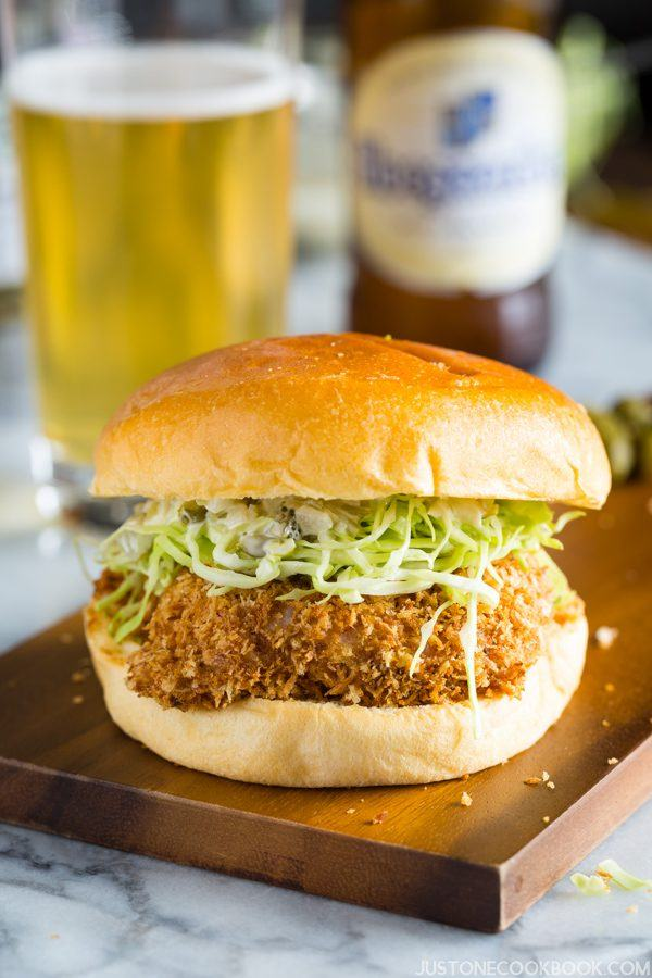 Ebi Katsu Burger and a glass of beer on a table.