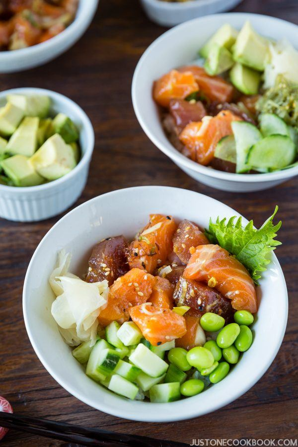 Poke Bowl with soy bean and avocado on the table.
