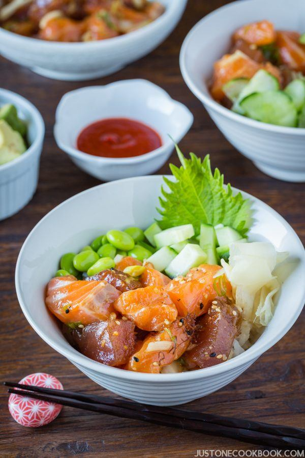 Poke Bowl with soy bean and cucumber on the wooden table.