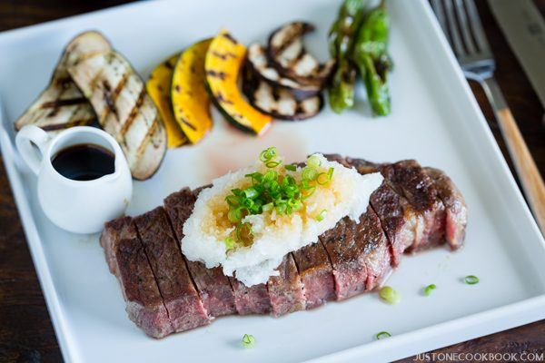 Sous Vide beef Steak and grilled vegetables on a white plate.