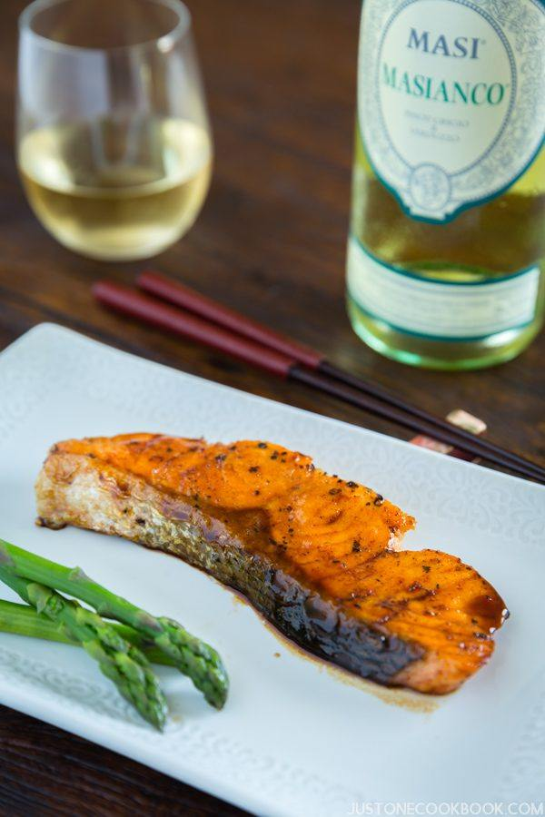 Terikyaki Salmon with MASI MASIANCO on the wooden table.