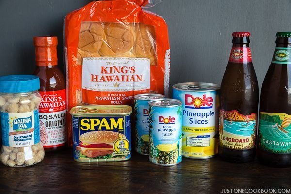 Hawaiian Products, nuts, Hawaiian BBQ sauce, spam, pineapple, sweet rolls and Hawaiian beer on a table.