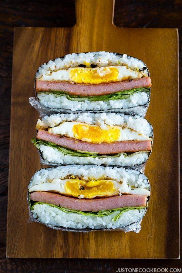 Spam Onigirazu is a Japanese rice sandwich with fried eggs, spam, and lettuce wrapped in nori seaweed