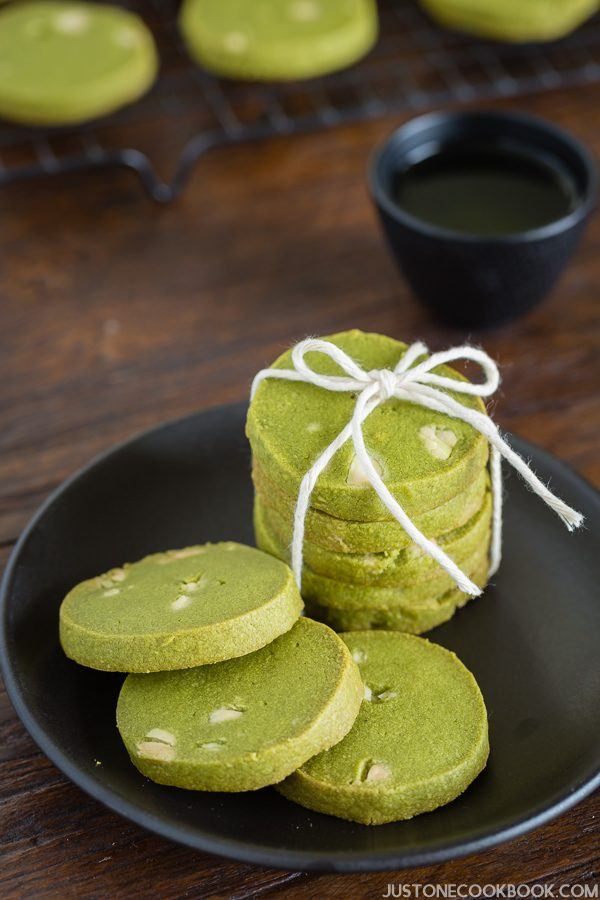 Green Tea Cookies on a black plate.
