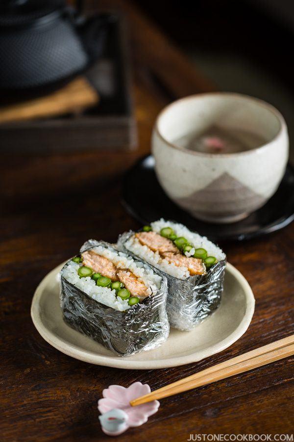 Teriyaki Salmon Onigirazu on a plate and a cup of tea.
