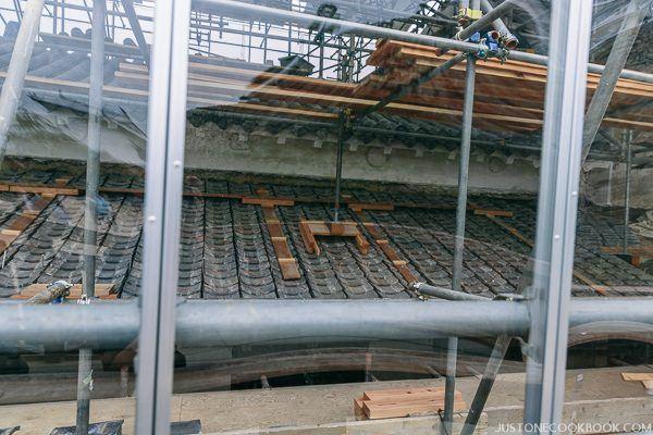 himeji castle under repair behind glass wall