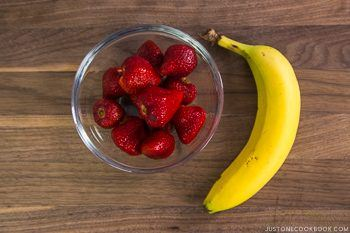 fresh strawberry and banana on a table.
