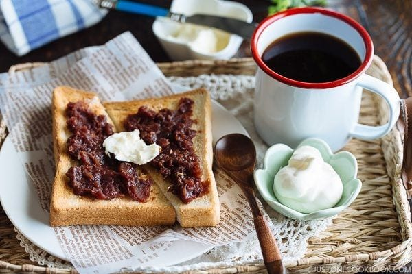 Ogura Toast, a small cup of whipped cream and a cup of coffee.