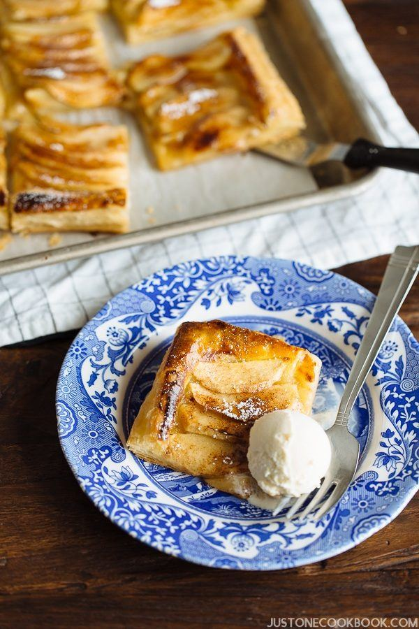 Easy Apple Tart on a small plate with whipped cream.