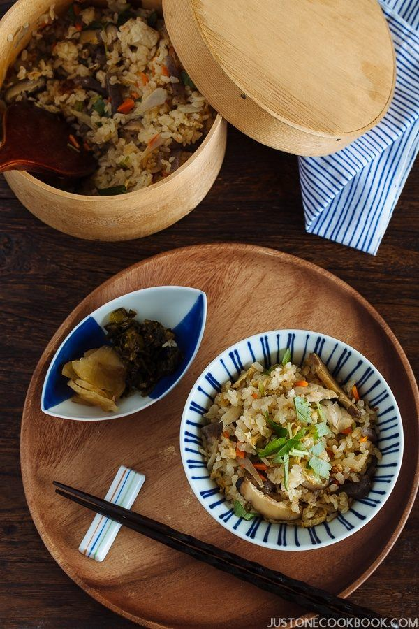 Takikomi Gohan in a rice bowl and a small plate of pickled on the wooden tray.
