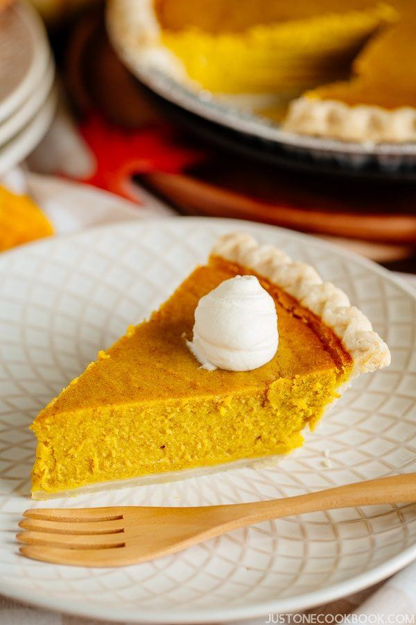 Kabocha Squash Pie (かぼちゃパイ) with whipped cream on plate.