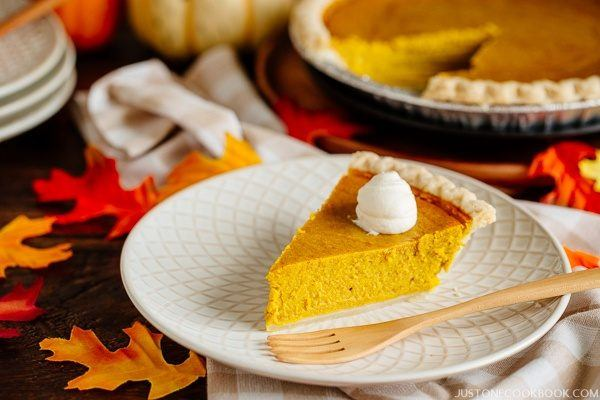 Kabocha Squash Pie and whipped cream on a small plate.
