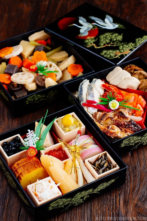 Osechi Ryori packed in 3 layers of lacquer boxes on wooden table
