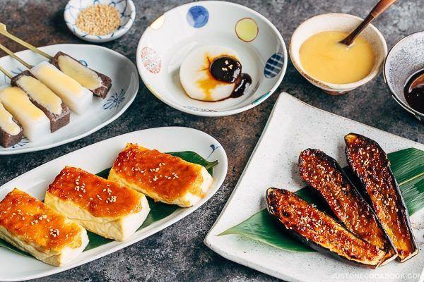 Miso Dengaku with Tofu, Eggplants, Daikon & Konnyaku on plates.