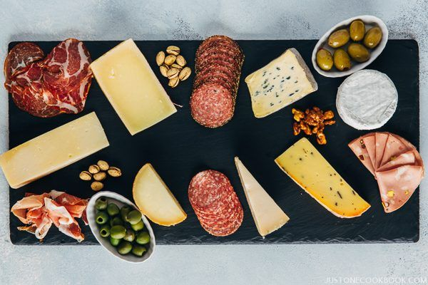 Cheese Board with olive, cheese and sliced meat.