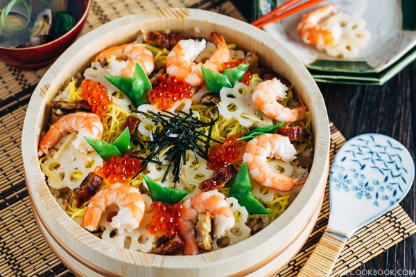Chirashi Sushi topped with shrimp and ikura in a bowl.