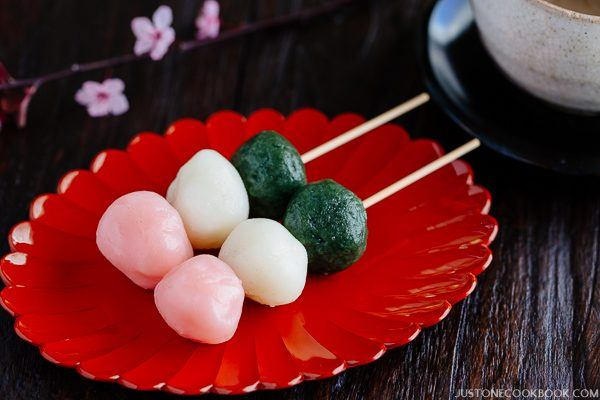 Hanami Dango on a red plate.