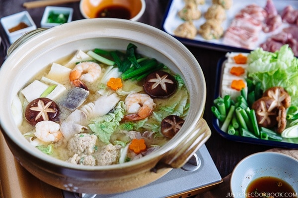 Chanko Nabe in a pot and a tray of ingredients.