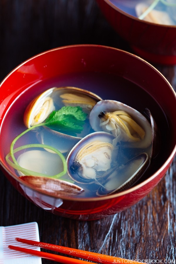 Japanese Clam Soup with Clear Broth in a red bowl.