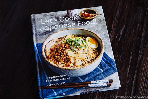 Let's Cook Japanese Food book on a table.