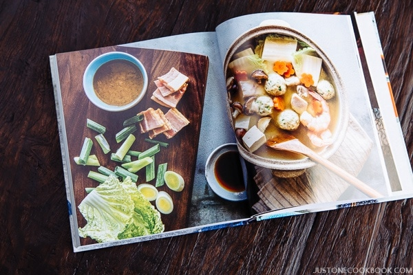 Let's Cook Japanese Food recipe book on the wooden table.