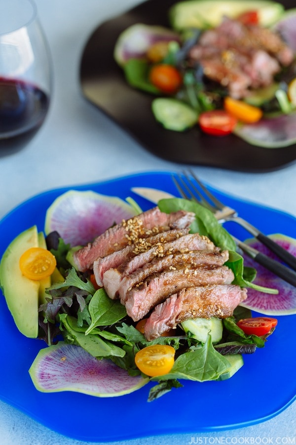 Steak Salad with Shoyu Dressing (gluten free) on a blue plate.