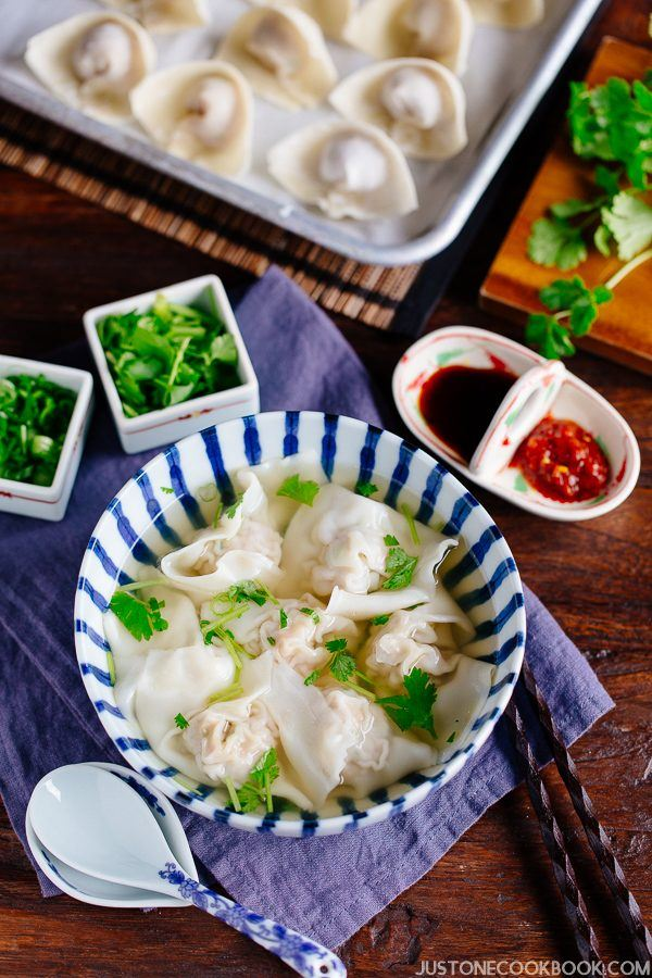 Shrimp and Pork Wonton Soup in a bowl and ingredients on the table.