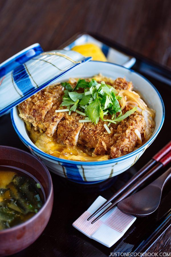 Baked Katsudon in Japanese bowl and a cup of miso soup on the tray.