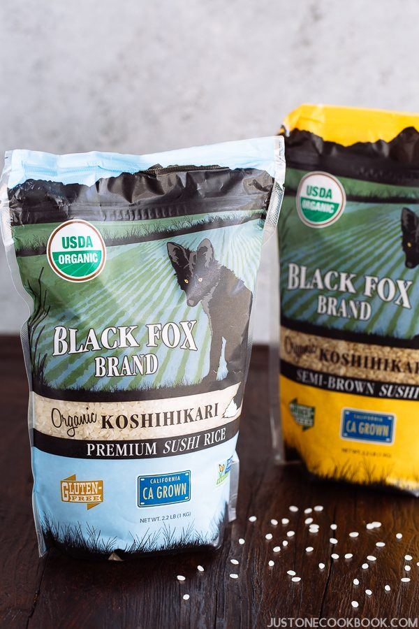 Black Fox Brand Koshihikari rice in bags on the table.