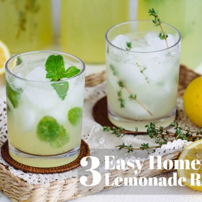 lemonade with ice in clear glass on top of clothes inside a tray