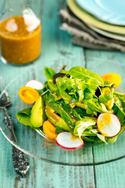 spring mix salad featuring radishes, avocado, heirloom tomatoes and fresh mint