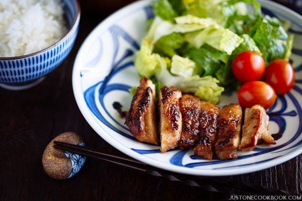 Chicken Teriyaki and salads on the plate with a bowl of rice.