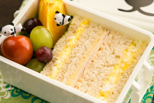 Egg salad sandwich and fruits in the bento box