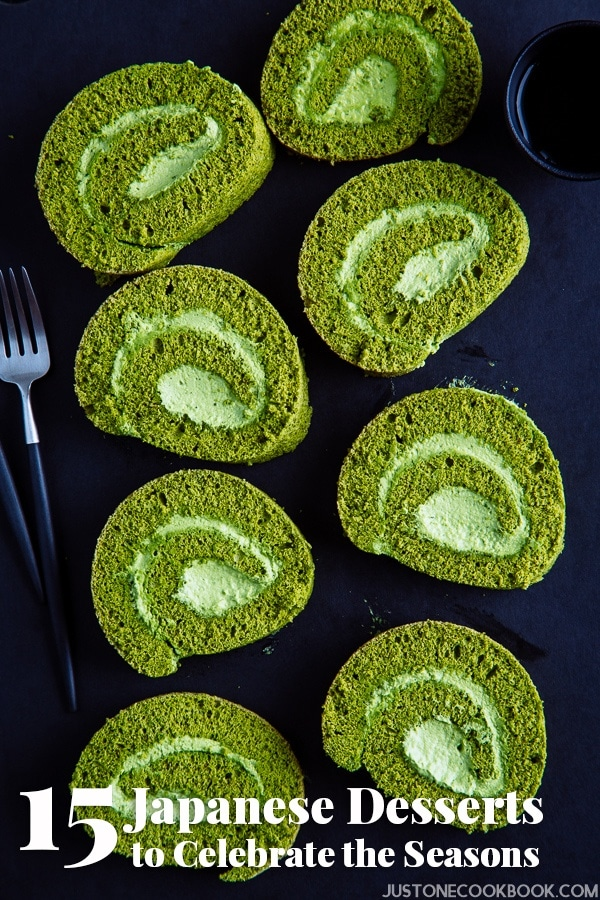 Matcha Swiss Roll Cake with fork and cup of tea.