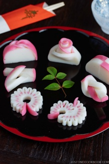 7 kinds of Decorative Kamaboko (Fish Cake) on a Japanese lacquer plate.