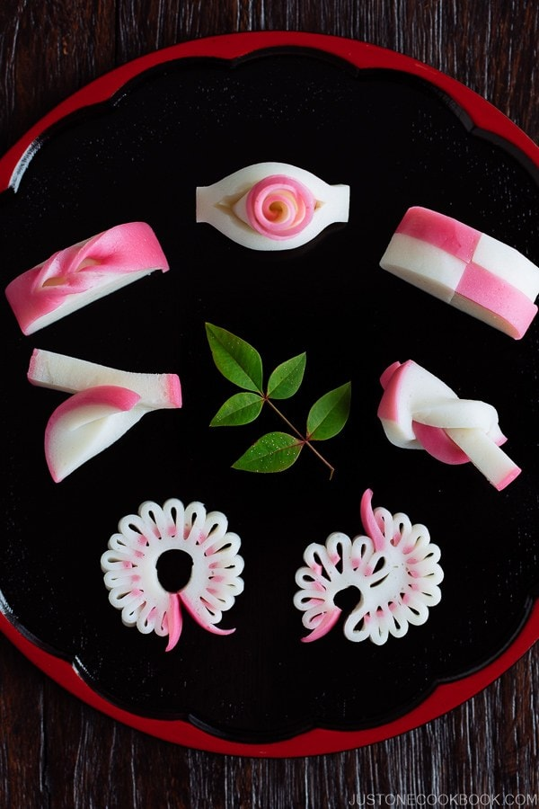 7 kinds of Decorative Kamaboko (Japanese Fish Cake) on a Japanese lacquer plate.