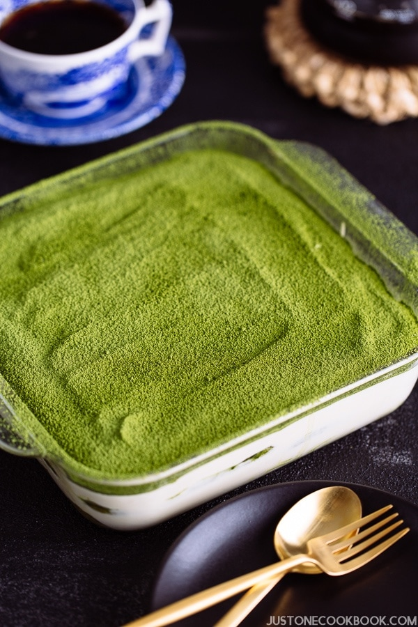Matcha Tiramisu in a clear glass baking sheet.