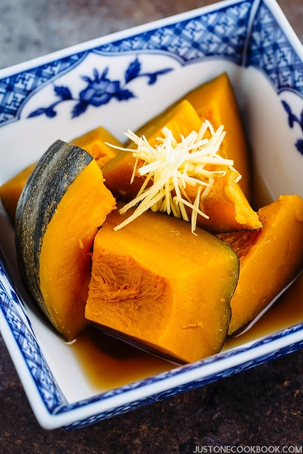 Close up shot of Simmered Kabocha Squash (Japanese Pumpkin) in a Japanese blue willow bowl.