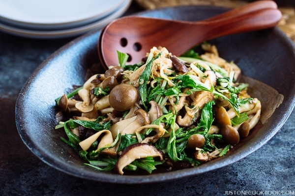 Warm Mushroom Salad with Sesame Dressing is served in a dark dish.