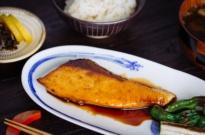 Yellowtail Teriyaki, Shishito Pepper, and Leek on the Japanese white plate.