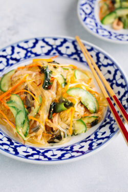 Japanese glass noodle salad consists of glass noodles, cucumber, wakame, carrots, and ham