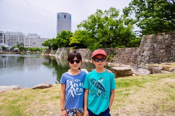 children standing in front of Hiroshima Castle wall | JustOneCookbook.com