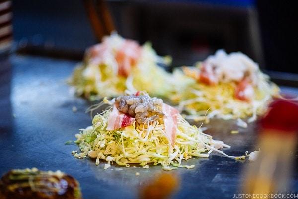 okonomiyaki being cooked at Mitchan in Hiroshima | Hiroshima Japan Guide JustOneCookbook.com