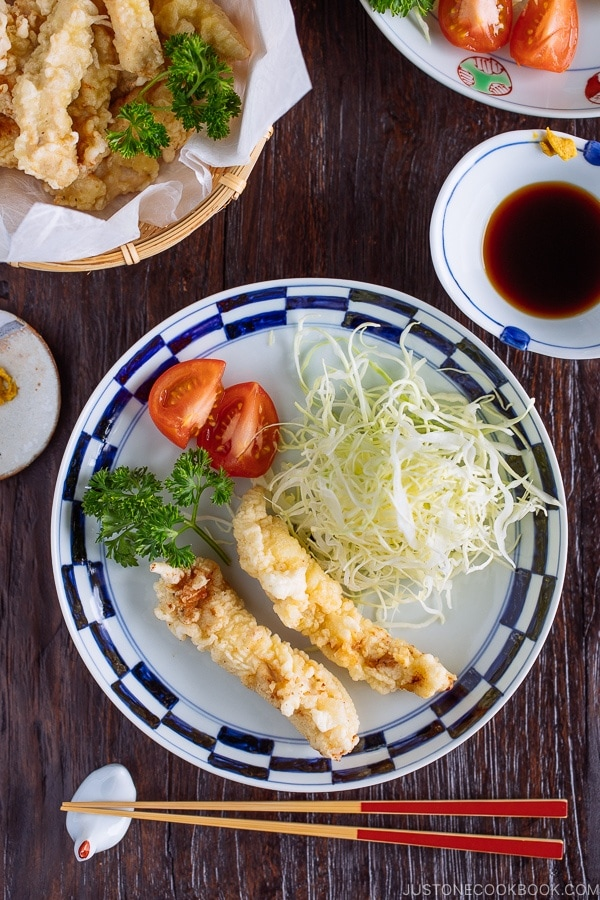 Japanese plate containing Chicken Tempura (Toriten) and shredded cabbaage, served with ponzu sauce and Japanese karashi hot mustard.