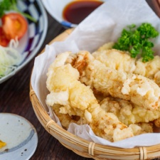Chicken Tempura (Toriten) in a bamboo basket, served with ponzu sauce and Japanese hot mustard karashi.