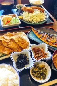 Japanese lunch meal set with ginger pork, grilled mackerel and korokke.